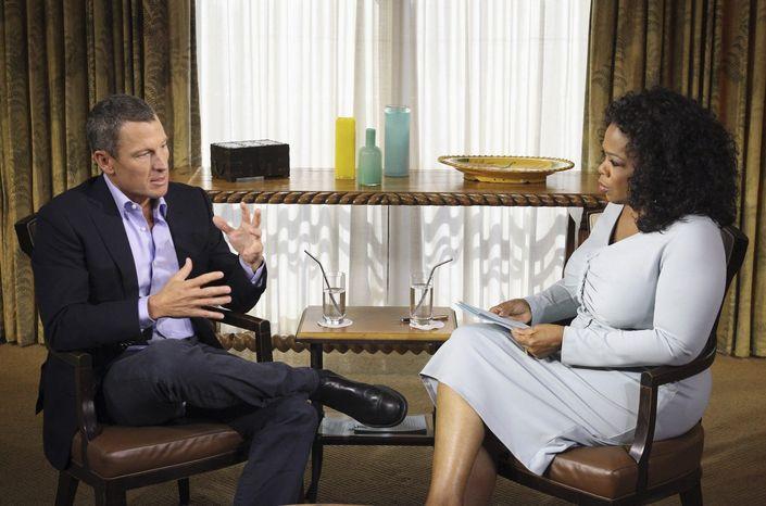 Cyclist Lance Armstrong is interviewed by talk-show host Oprah Winfrey on Monday, Jan. 13, 2013, in Austin, Texas. (AP Photo/Harpo Studios Inc., George Burns)