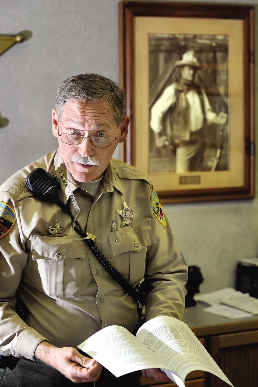 Josephine County Sheriff Gil Gilbertson, pictured in his office in Grants Pass, Ore., is one of a growing number of rural sheriffs vowing to ignore any new federal gun-control legislation and lawmakers wanting to make it a crime for federal officials to enforce federal gun policy in their states. (AP Photo/Mail Tribune, Bob Pennell)