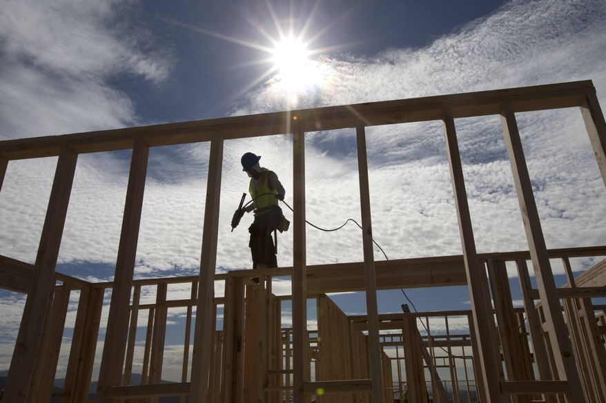 ** FILE ** In this Friday, Nov. 16, 2012, photo, construction worker Elabert Salazar works on a house frame for a new home in Chula Vista, Calif. (AP Photo/Gregory Bull)