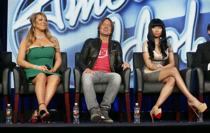 """In this Jan. 8, 2013, photo, from left, Mariah Carey, Keith Urban and Nicki Minaj from """"American Idol"""" attend the Fox Winter TCA Tour at the Langham Huntington Hotel, in Pasadena, Calif. (Photo by Todd Williamson/Invision/AP)"""