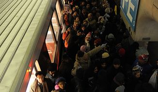 Patrons crowd the L'Enfant Metro station in the early morning on inauguration day on the National Mall in Washington D.C., Tuesday, Jan. 20, 2009.  (Allison Shelley / The Washington Times)