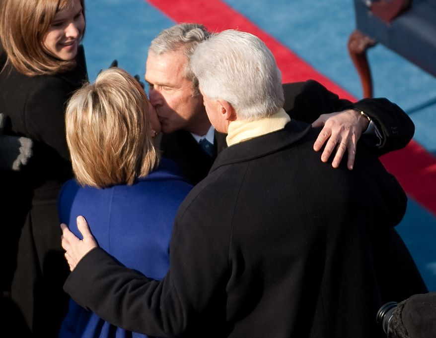 President George W. Bush (center) kisses Hillary Clinton while putting his arm around former President Bill Clinton before the inauguration of Barack Obama as the 44th President of the United States at the Capitol in Washington, D.C. Tuesday, January 20, 2009. (Michael Connor / The Washington Times)