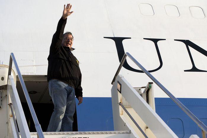 U.S. Defense Secretary Leon Panetta waves goodbye as he departs Rome en route to Vincenza, Italy on Thursday, Jan. 17, 2013. (AP Photo/Jacquelyn Martin)