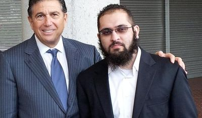 Lawyer Joseph Rosenbaum (left) and his client Izhar Khan stand outside the U.S. Courthouse in Miami on Thursday, Jan. 17, 2013. A federal judge dismissed terrorism support and conspiracy charges against Mr. Khan, who was accused with his father of funneling cash to the Pakistani Taliban. The trial for Mr. Khan's father, 77-year-old Hafiz Khan, is continuing in federal court. (AP Photo/Courtesy of Joseph Rosenbaum, P.A.)