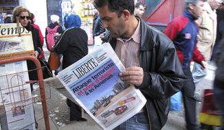 """A man reads a newspaper headlining """"Terrorist attack and kidnapping in In Amenas,"""" at a newsstand in Algiers, Thursday, Jan. 17, 2013. Algerian forces raided a remote Sahara gas plant on Thursday in an attempt to free dozens of foreign hostages held by militants with ties to Mali's rebel Islamists, diplomats and an Algerian security official said. (AP Photo/Ouahab Hebbat)"""