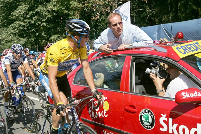 ** FILE ** In this July 20, 2005, file photo, overall leader Lance Armstrong, left, of Austin, Texas, talks with Tour de France vice director general Christian Prudhomme, of France, before Prudhomme gave the official start for the 17th stage of the Tour de France cycling race between Pau and Revel, southwestern France. (AP Photo/Christophe Ena, File)