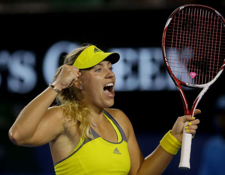 Germany's Angelique Kerber celebrates after defeating Madison Keys of the United States in their third-round match at the Australian Open tennis championship in Melbourne, Australia, on Friday, Jan. 18, 2013. (AP Photo/Dita Alangkara)