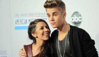 ** FILE ** In this Nov. 18, 2012, file photo, Justin Bieber, right, and his mother, Pattie Mallette, arrive at the 40th Anniversary American Music Awards, in Los Angeles. (Photo by Jordan Strauss/Invision/AP, File)
