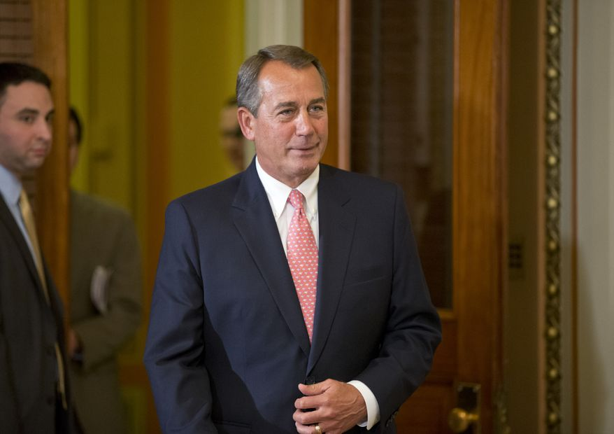 ** FILE ** House Speaker John A. Boehner, Ohio Republican, walks to his ceremonial office off the House floor to greet new members of Congress at the Capitol in Washington on Monday, Jan. 14, 2013. (Associated Press)