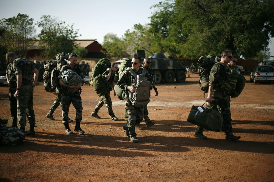 French troops arrive at Bamako's airport on Jan. 17, 2013, as fighting raged in one Mali town, airstrikes hit another and army troops raced to protect a third on the seventh day of the French-led military intervention to wrest back Mali's north from al Qaeda-linked groups. (Associated Press)