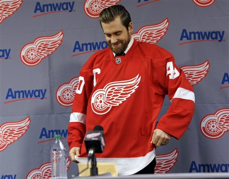 Detroit Red Wings' Henrik Zetterberg smiles during an NHL hockey news conference announcing his appointment as team captain at Compuware Arena in Plymouth, Mich., Tuesday, Jan. 15, 2013. Zetterberg replaces retired defenseman Nicklas Lidstrom. (AP Photo/Detroit News, David Guralnick)