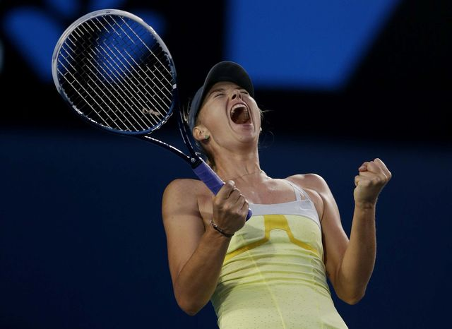 Russia's Maria Sharapova celebrates after defeating Venus Williams of the U.S. in their third round match at the Australian Open tennis championship in Melbourne, Australia, Friday, Jan. 18, 2013. (AP Photo/Dita Alangkara)