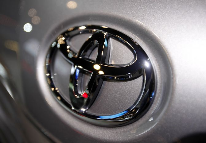 **FILE** The Toyota logo is seen on a car at the New York International Auto Show in New York on March 31, 2010. (Associated Press)