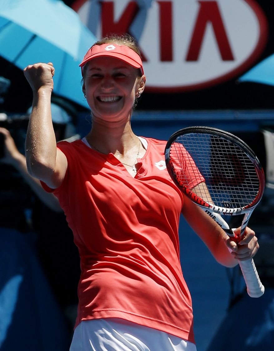 Russia's Ekaterina Makarova celebrates after defeating Germany's Angelique Kerber in their fourth round match at the Australian Open tennis championship in Melbourne, Australia, Sunday, Jan. 20, 2013. (AP Photo/Dita Alangkara)