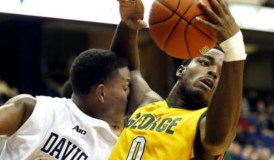 FILE -- George Mason's Byron Allen (0) pulls in a rebound as Richmond's Trey Davis (5) gets a faceful of bicep during first half action of an NCAA college basketball game in the 2012 Governor's Holiday Hoops Classic at The Richmond Coliseum in Richmond, VA.,Saturday,Dec.,22,2012. (AP Photo/The Richmond Times-Dispatch, Joe Mahoney)