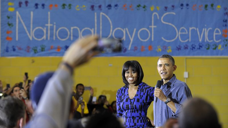 President Barack Obama, accompanied by first lady Michelle Obama, speaks at Burrville Elementary School in Washington, Saturday, Jan. 19, 2013, after the first family participated in a community service project for the National Day of Service as part of the 57th Presidential Inauguration. (AP Photo/Susan Walsh)
