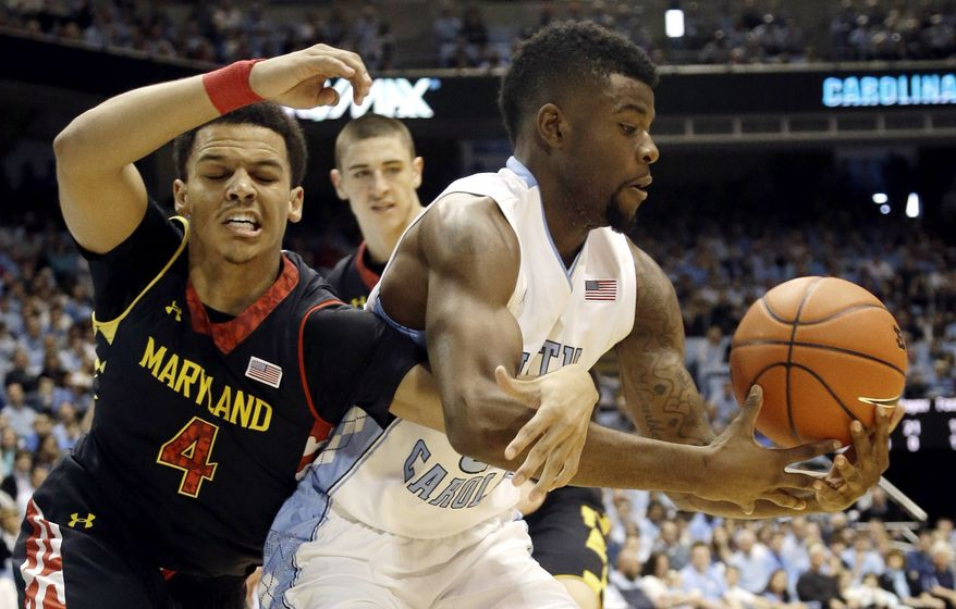 North Carolina's Reggie Bullock, right, and Maryland's Seth Allen (4) reach for a loose ball during the first half of an NCAA college basketball game in Chapel Hill, N.C., Saturday, Jan. 19, 2013. (AP Photo/Gerry Broome)