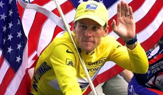 ** FILE ** In this July 23, 2000, file photo, winner Lance Armstrong rides down the Champs Elysees after the final stage of the Tour de France cycling race in Paris. (AP Photo/Laurent Rebours, File)