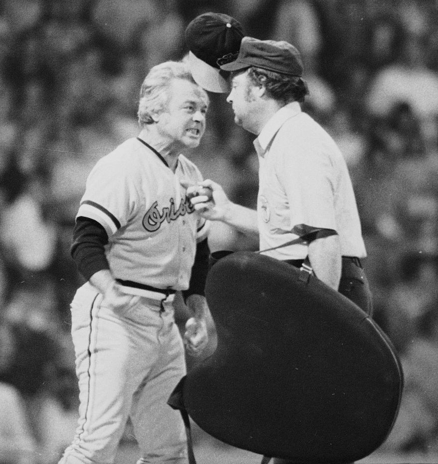 "** FILE ** In this July 13, 1974, file photo, Baltimore Orioles manager Earl Weaver literally ""flips his lid"" as he protests a call by home plate umpire Marty Springstead during a baseball game against the Chicago White Sox in Chicago. Weaver, the fiery Hall of Fame manager who won 1,480 games with the Baltimore Orioles, has died, the team announced Saturday, Jan. 19, 2013. He was 82. (AP Photo/File)"