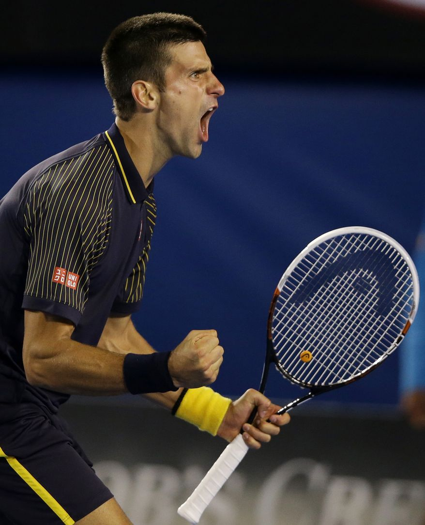 Serbia's Novak Djokovic reacts during his fourth round match against Switzerland's Stanislas Wawrinka at the Australian Open tennis championship in Melbourne, Australia, Sunday, Jan. 20, 2013.(AP Photo/Dita Alangkara)