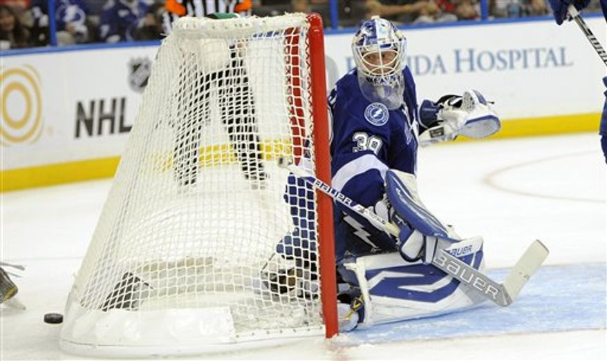 Tampa Bay Lightning goalie Anders Lindback, of Sweden, looks back at the puck during the third period of an NHL hockey game against the Washington Capitals on Saturday, Jan. 19, 2013, in Tampa, Fla. The Lightning won 6-3. (AP Photo/Brian Blanco)