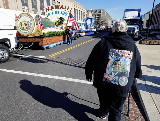 Luci Brown of South Bend, Ind., looks at the floats prepared for the 57th Presidential Inaugural Parade, Sunday, Jan. 20, 2013 in Washington. Thousands are planning to march in the 57th Presidential Inauguration parade after the ceremonial swearing-in of President Barack Obama on Monday. (AP Photo/Alex Brandon)