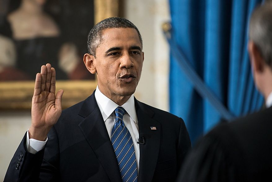 President Barack Obama is officially sworn-in by Chief Justice John Roberts in the Blue Room of the White House during the 57th Presidential Inauguration in Washington, Sunday, Jan. 20, 2013. (AP Photo/Brendan Smialowski, Pool)