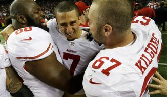 San Francisco 49ers' Colin Kaepernick (7) celebrates with Leonard Davis and Daniel Kilgore (67) after the NFL football NFC Championship game against the Atlanta Falcons Sunday, Jan. 20, 2013, in Atlanta. The 49ers won 28-24 to advance to Superbowl XLVII. (AP Photo/Dave Martin)