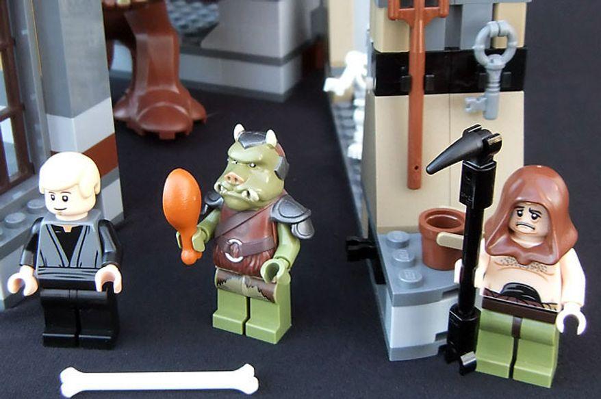 The Lego Star Wars Rancor Pit set includes the minifigures Luke Skywalker, a Gamorrean guard and Malakili. (Joseph Szadkowski/The Washington Times)