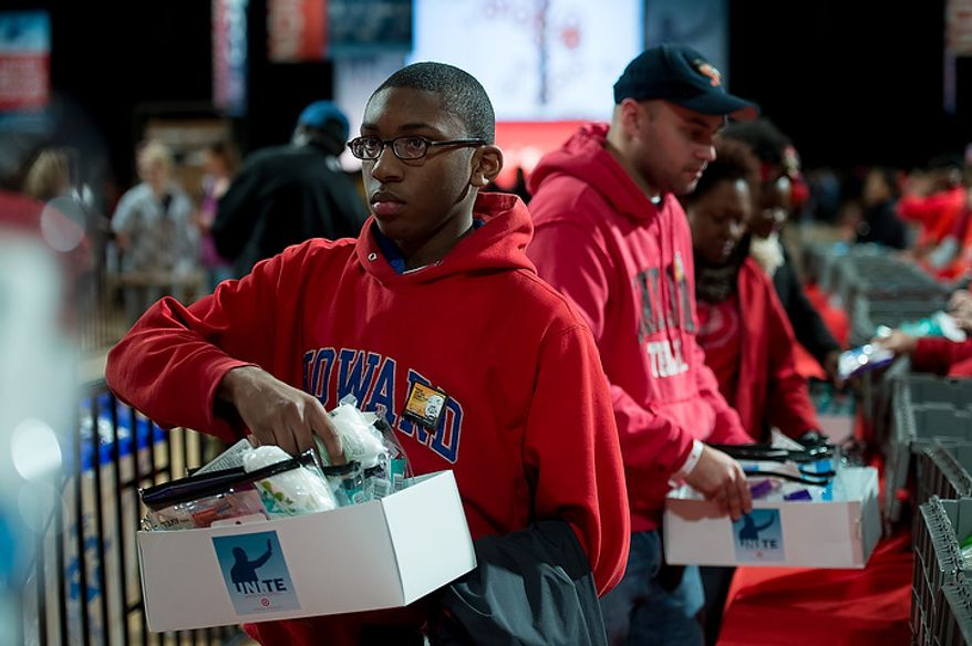 Volunteer Joe Jones of Washington, D.C. puts together a service package for members of the armed services abroad during the National Day of Service at the D.C. Armory, Washington, D.C., Saturday, January 19, 2013. Non-profit groups are running hundreds of service projects for the Martin Luther King Jr. weekend. (Andrew Harnik/The Washington Times)