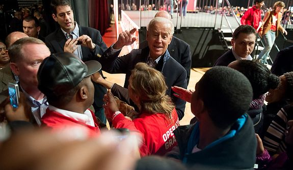 Vice President Joseph Biden shakes hands and take photos with volunteers who put together service packages for members of the armed services abroad during the National Day of Service at the D.C. Armory, Washington, D.C., Saturday, January 19, 2013. Non-profit groups are running hundreds of service projects for the Martin Luther King Jr. weekend. (Andrew Harnik/The Washington Times)