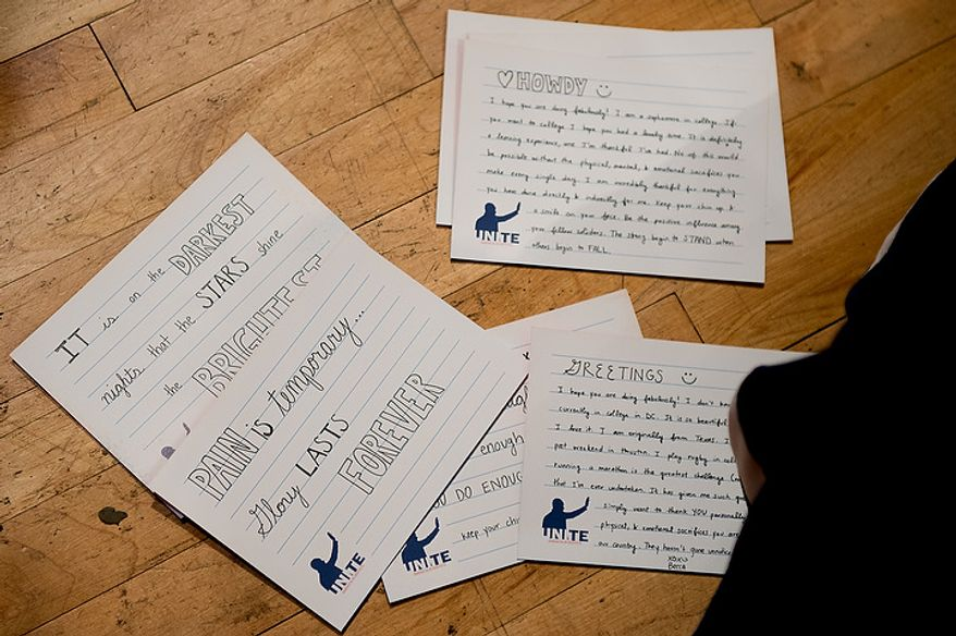 George Washington University student Rebecca Prather, right, and dozens of other volunteers write handwritten letters to service members to go along with service packages for members of the armed services abroad during the National Day of Service at the D.C. Armory, Washington, D.C., Saturday, January 19, 2013. Non-profit groups are running hundreds of service projects for the Martin Luther King Jr. weekend. (Andrew Harnik/The Washington Times)