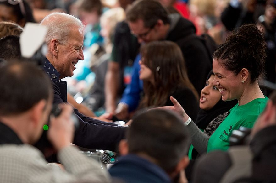 Vice President Joseph Biden participates in putting together service packages for members of the armed services abroad during the National Day of Service at the D.C. Armory, Washington, D.C., Saturday, January 19, 2013. Non-profit groups are running hundreds of service projects for the Martin Luther King Jr. weekend. (Andrew Harnik/The Washington Times)