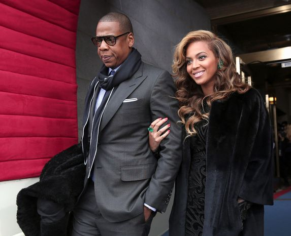 """Jay-Z and his wife Beyonce arrive on the West Front of the Capitol on Monday morning for President Obama's swearing-in. Beyonce closed the festivities with """"The Star-Spangled Banner."""" (Associated Press)"""
