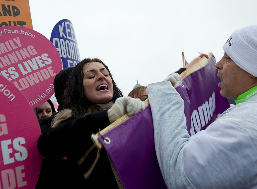 In what has become an annual scene in front of the Supreme Court on the anniversary of the landmark Roe v. Wade decision legalizing abortion, pro-choice advocates clash with pro-life demonstrators participating in the March for Life. (The Washington Times)