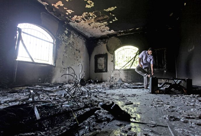 A Libyan man walks inside the U.S. Consulate in Benghazi, Libya, two days after the attack that left Ambassador J. Christopher Stevens and three other Americans dead on Sept. 11. Republicans are seeking answers to lingering questions about the attack from Secretary of State Hillary Rodham Clinton this week. (Associated Press)
