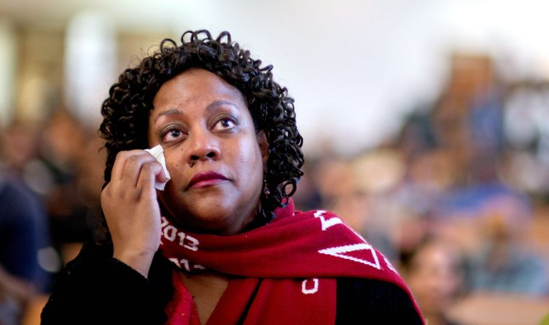 Herschelle Adams, of Atlanta, wipes away a tear while watching a broadcast of the inauguration of President Obama with others at Ebenezer Baptist Church in Atlanta. (Associated Press)