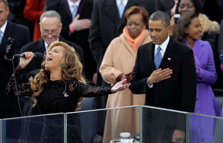 President Obama holds his hand over his heart at the swearing-in ceremony for his second term Monday while pop star Beyonce sings the national anthem. James Taylor and Kelly Clarkson also sang during the ceremony at the Capitol. (Associated Press)