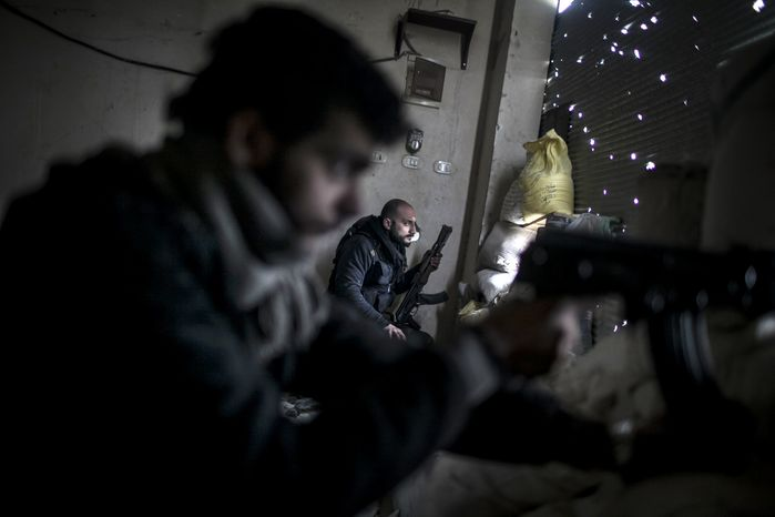 Free Syrian Army fighters hold their weapons during heavy clashes with government forces in Aleppo, Syria, on Sunday, Jan. 20, 2013. (AP Photo/Andoni Lubaki)