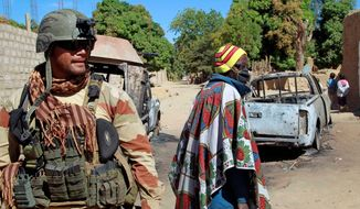 ** File ** A French soldier secures a perimeter on the outskirts of Diabaly, Mali. (Associated Press)