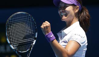 Li Na celebrates after defeating Agnieszka Radwanska in their quarterfinal match at the Australian Open in Melbourne, Australia on Jan. 22, 2013. (Associated Press)