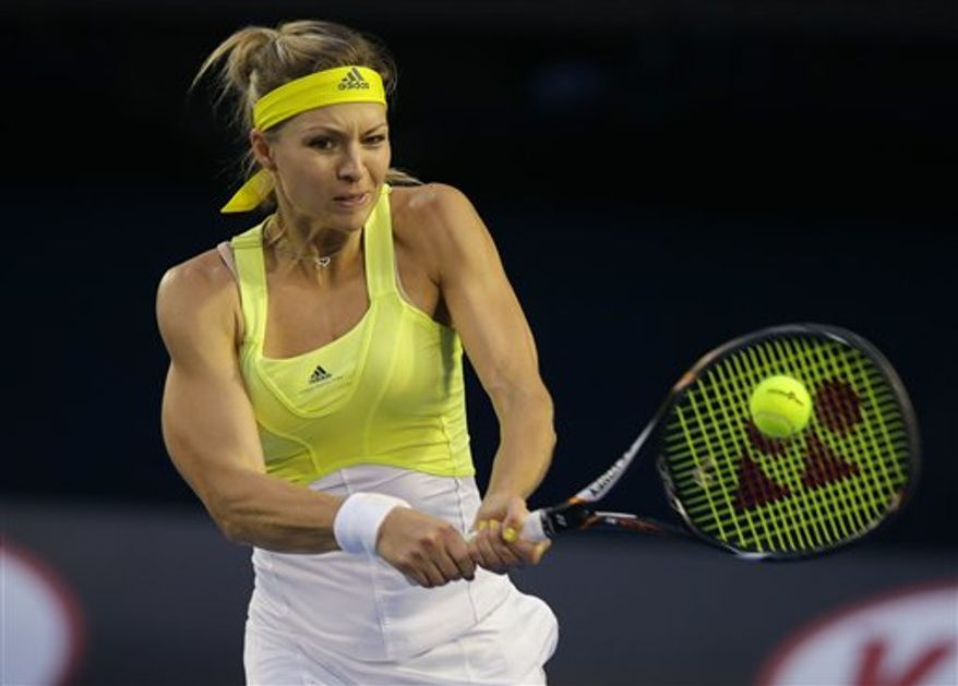 Russia's Maria Kirilenko hits a return to Serena Williams of the US during their fourth round match at the Australian Open tennis championship in Melbourne, Australia, Monday, Jan. 21, 2013. (AP Photo/Dita Alangkara)