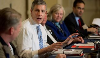 """If you drop out of high school, how many good jobs are there out there for you? None. That wasn't true 10 or 15 years ago,"" Education Secretary Arne Duncan said while discussing the national increase in high school graduation rates. (Associated Press)"