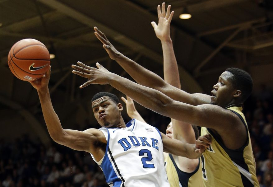 Duke's Quinn Cook (2) looks to pass as Georgia Tech's Robert Carter (4) defends during the first half of an NCAA college basketball game in Durham, N.C., Thursday, Jan. 17, 2013. (AP Photo/Gerry Broome)