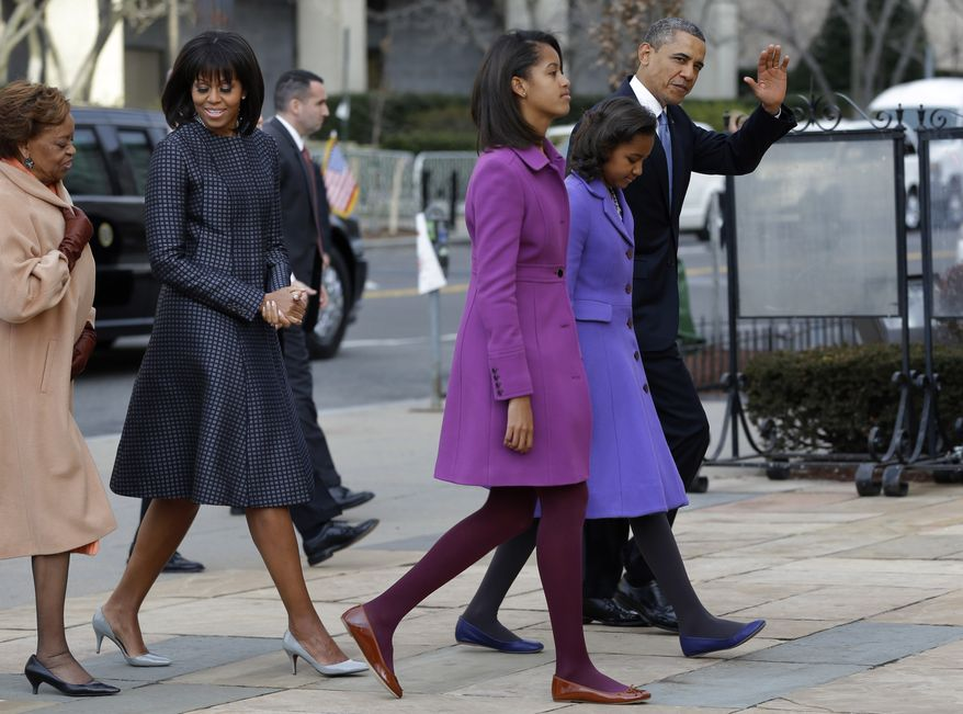 President Obama waves as he walks to St. John's Episcopal Church with (from left) his his mother-in-law, Marian Robinson; first lady Michelle Obama; and the Obamas' daughters, Malia and Sasha, on Monday, Jan. 21, 2013, in Washington. (AP Photo/Jacquelyn Martin)