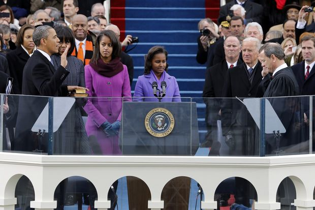 President Obama takes the oath of office from Chief Justice John G. Roberts Jr. at the ceremonial swearing-in on the West Front of the U.S. Capitol during the 57th Presidential Inauguration in Washington on Monday, Jan. 21, 2013. (AP Photo/Scott Andrews, Pool)