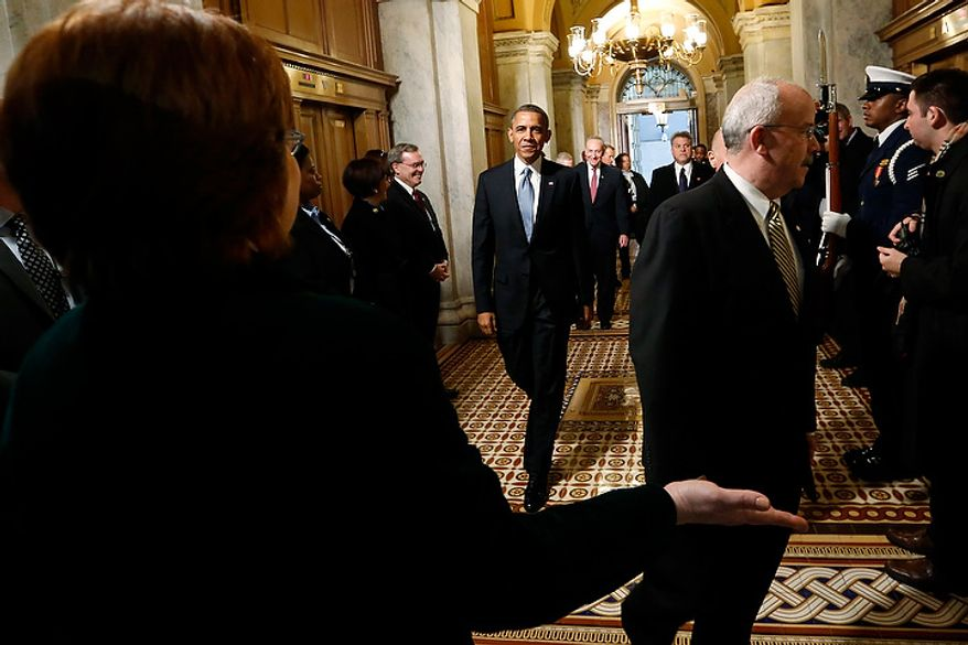 U.S. President Barack Obama (C) is directed as he arrives at the senate carriage entrance for swearing-in ceremonies at the U.S Capitol in Washington, January 21, 2013.   REUTERS/Jonathan Ernst