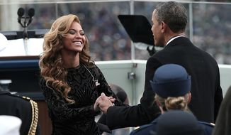 U.S. President Barack Obama greets singer Beyonce after she performs the National Anthem during the public ceremonial inauguration on the West Front of the U.S. Capitol January 21, 2013 in Washington, DC.   Barack Obama was re-elected for a second term as President of the United States.  (Photo by POOL Win McNamee/Getty Images)