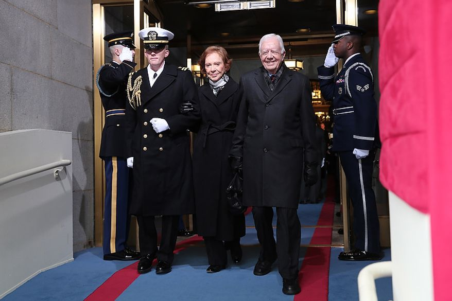 Former U.S. President Jimmy Carter and wife Rosalynn Carter arrive during the presidential inauguration on the West Front of the U.S. Capitol January 21, 2013 in Washington, DC.   Barack Obama was re-elected for a second term as President of the United States.  (Photo by POOL Win McNamee/Getty Images)