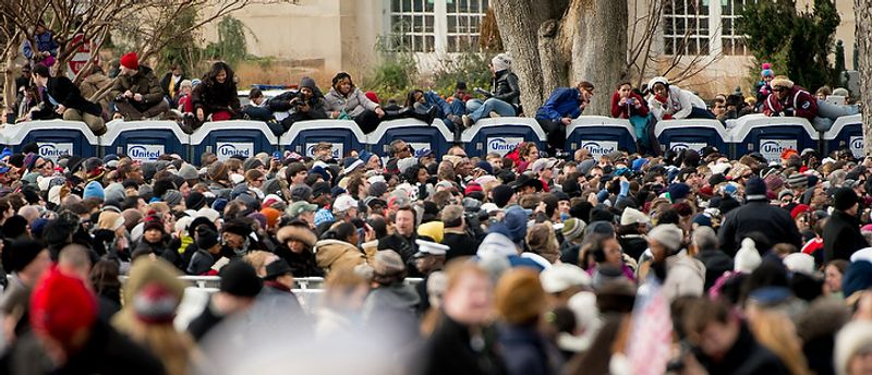 Crowd members sit on top of portable toilets before President Barack Obama is sworn in for his second term on the West Lawn of the U.S. Capitol Building at the 57th Presidential Inauguration Ceremony, Washington, D.C., Monday, January 21, 2013. (Andrew Harnik/The Washington Times)